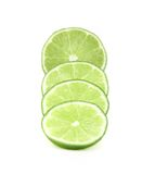 Slices of lime, Isolated on white background Royalty Free Stock Photo