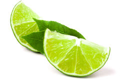 Slices of lime with leaves isolated on white background Stock Images