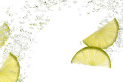 Slices of lime in water. On white Stock Photography