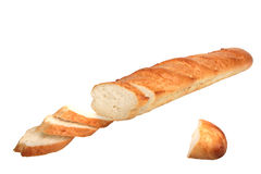 Slices of loaf of baguette. Close-up. Isolated on white background Stock Photos
