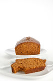 Slices and loaf of freshly baked pumpkin bread. Slices and loaf of freshly homemade pumpkin bread on white, isolating background (vertical Royalty Free Stock Photo