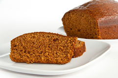 Slices and loaf of freshly baked pumpkin bread. Slices and loaf of freshly homemade pumpkin bread on white, isolating background Royalty Free Stock Image