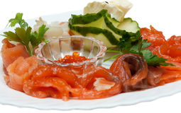 Slices of the lox, red roe, cucumber Royalty Free Stock Photo