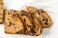 Slices of malt bread handmade. With nuts, raisins and cranberries on white background Royalty Free Stock Photo