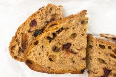 Slices of malt bread handmade. With nuts, raisins and cranberries on white background Royalty Free Stock Photos