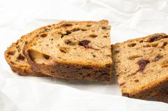 Slices of malt bread handmade. With nuts, raisins and cranberries on white background Royalty Free Stock Photography