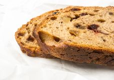 Slices of malt bread handmade. With nuts, raisins and cranberries on wooden background Royalty Free Stock Photos