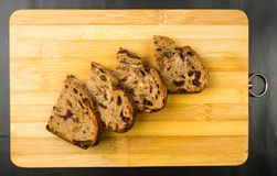 Slices of malt bread handmade. With nuts, raisins and cranberries on wooden background Royalty Free Stock Image