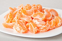 Slices of mandarin Stock Images