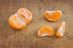 Slices of mandarin fruit Stock Photos