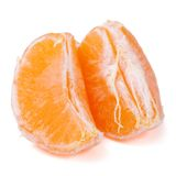 Slices of mandarin isolated on white background. Stock Photo
