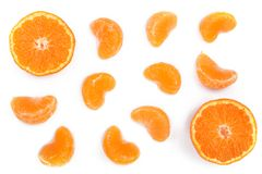 Slices of mandarin or tangerine with leaves isolated on white background. Flat lay, top view. Fruit composition.  Royalty Free Stock Photos