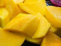 Fresh Cut Mango Fruits Macro. Slices of Mango fruit closeup ready to serve stock photos