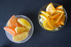 Slices of marmalade. lemon and orange pieces in plate. Yellow an Stock Photo