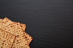 Slices of matzo on plate, board, tray of black slate. Fresh East royalty free stock photos