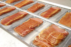 Slices of meat. The slices of meat packing line Stock Photography