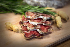 Slices of meat with peanuts. French meat sliced with peanuts stock image