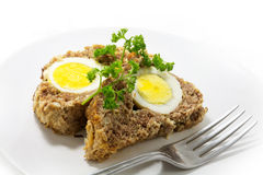 Slices of  meatloaf with boiled eggs  for Easter Royalty Free Stock Photography