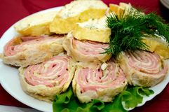 Slices of meatloaf lie on a plate decorated with greenery royalty free stock photos