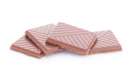 Slices of milk chocolate  on white background. Horizontal Stock Photography