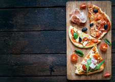 Slices of mini pizza Stock Images