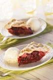 Slices of Mixed Berry Pie with Ice Cream Stock Photo