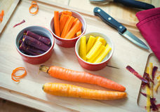 Slices od Fresh Raw Organic Carrots in cups. Slices of raw organic rainbow carrots in small cups Royalty Free Stock Photo