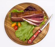 Slices Of Bacon On The Wooden Plate With Kni Royalty Free Stock Images