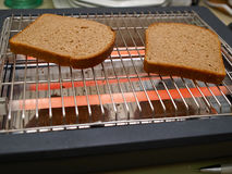 Slices Of Bread Toasted On A Flat Toaster Stock Photos