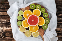 Free Slices Of Citrus Fruits On Chopping Board With Silk Royalty Free Stock Images - 72336189