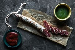 Free Slices Of French Saucisson Salami On A Grey Background Stock Images - 130187004