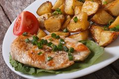Slices Of Fried Potatoes With Chicken Steak Stock Photo
