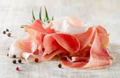 Slices Of Ham And Herbs Stock Photo