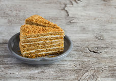 Free Slices Of Honey Cake On A Ceramic Plate Royalty Free Stock Image - 64427436