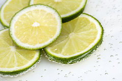 Slices offresh green lime Stock Photos