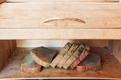 Slices of old moldy rye bread on wooden shelf Royalty Free Stock Photo