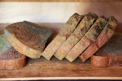 Slices of old moldy rye bread on wooden shelf Royalty Free Stock Photography