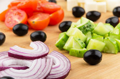 Slices of onions, tomatoes, peppers, cucumbers and black olives Royalty Free Stock Images