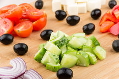 Slices of onions, tomatoes, peppers, cucumbers, cheese Stock Images