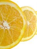 Slices of an Orange. Shot of three slices of an orange over white stock photo