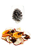 Slices of orange,apple with star anise and cone in a glass. Stock Images