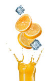 Slices of orange falling into juice splash Royalty Free Stock Photo