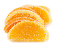 Slices of orange and jelly candies Stock Image