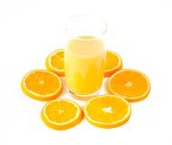 Slices of orange and orange juice. On white stock photography