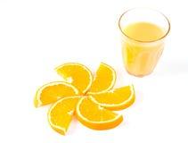 Slices of orange and orange juice. On white stock photo
