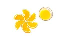 Slices of orange and orange juice. On white royalty free stock photography