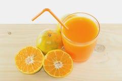 Slices of orange with orange juice fresh in glass. Slices of orange with orange juice fresh in glass isolated on wooden table white background Stock Image