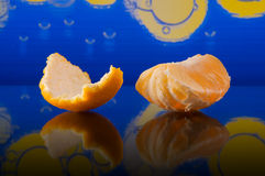 Slices of orange and peel on abstract background Stock Photography