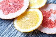 Slices of orange and red grapefruit. Citrus fruits on vintage gray color table texture Royalty Free Stock Photo