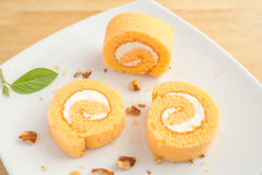 The slices of orange roll cake Stock Image